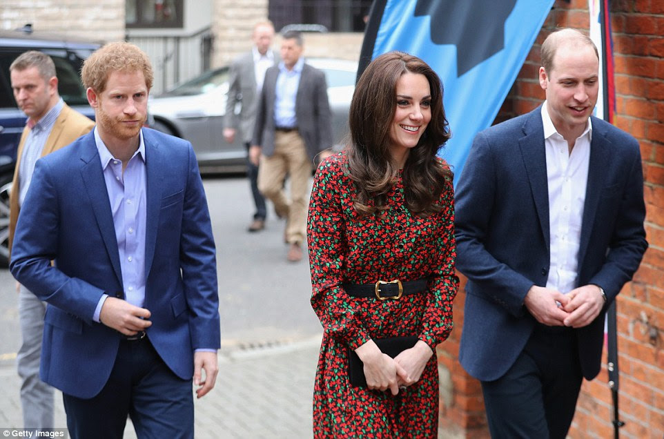 Kate was in a £720 Christmassy-red and green patterned dress by a new choice of label, Vanessa Seward