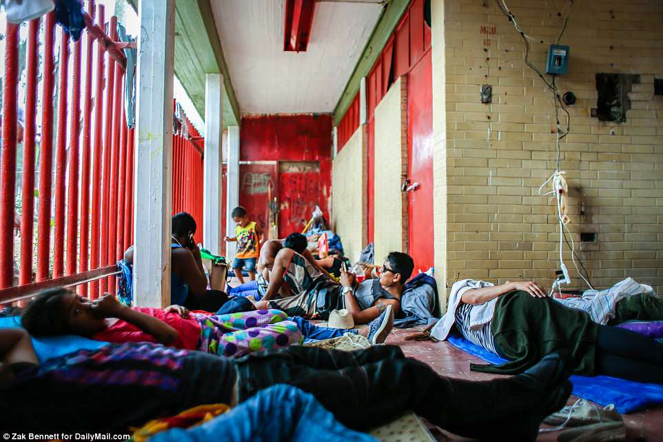 With no homes to go to, migrants are sleeping on mats surrounded by their belongingsinside the Ferrocarrilero VÌctor F. Morales Sports Center