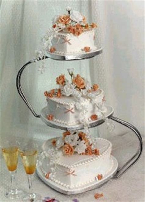wedding cake royal iced with orange flowers and heart