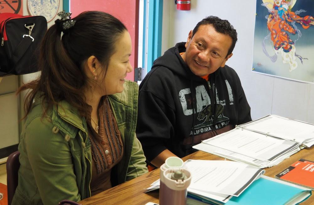 Marco Estrella, right, and Yu Liu practice English in an ESL class at San Mateo Adult School.