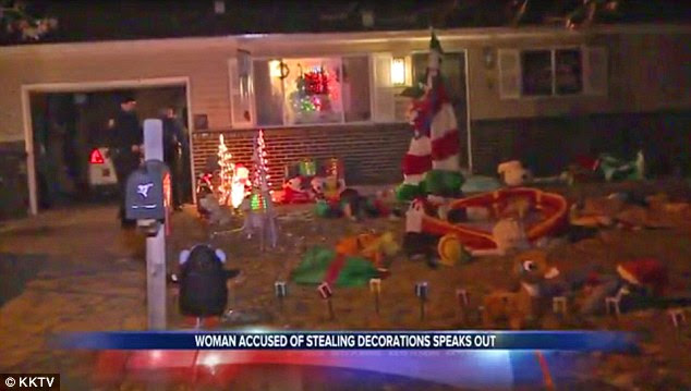 Booty: The Grinches then used the pilfered Christmas displays to deck  their own front yard