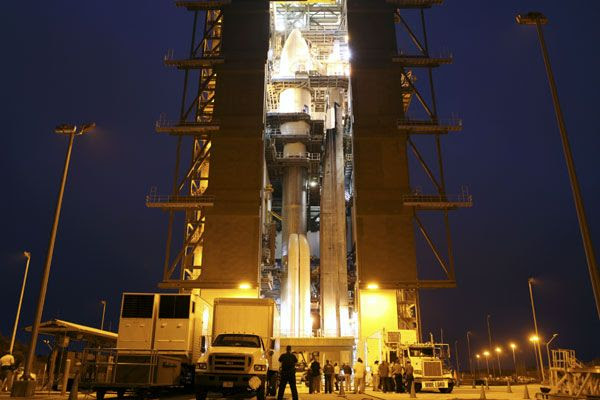 Work continues being done on the Atlas V rocket, which carries the Mars Science Laboratory spacecraft onboard, at Cape Canaveral Air Force Station in Florida on November 17, 2011.