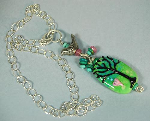 folk art bird and tree necklace