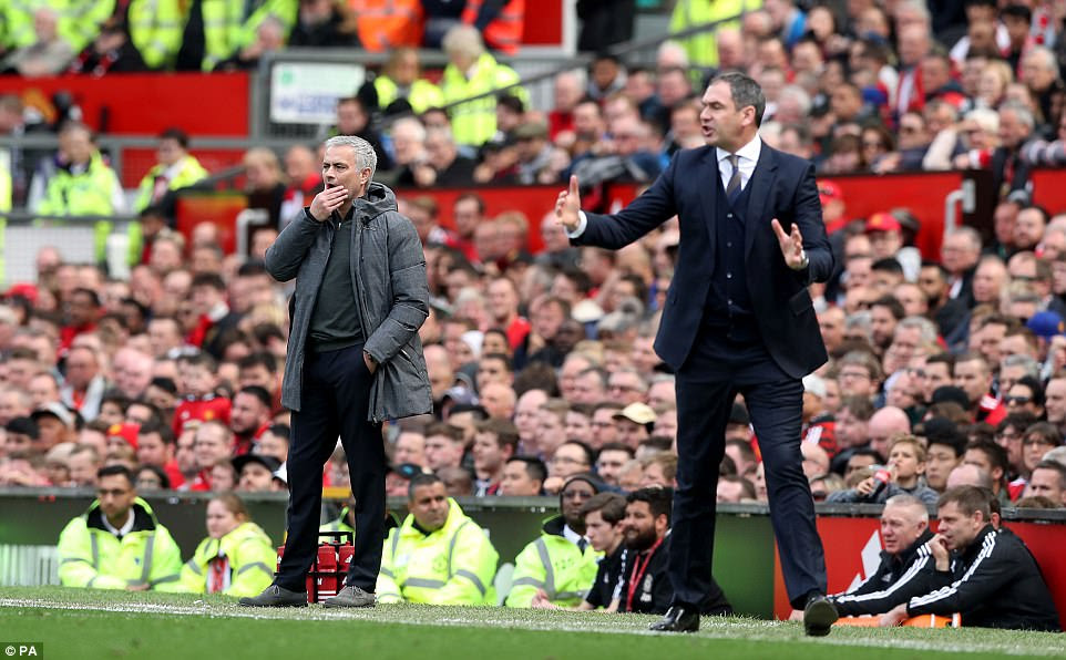 Mourinho looks on from the touchline while Clement cajoles his side to get an equaliser during the second half