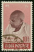 Pink-and-brown stamp with Gandhi's head and shoulders, facing left