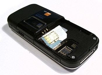 English: A mini SIM card next to its electrica...