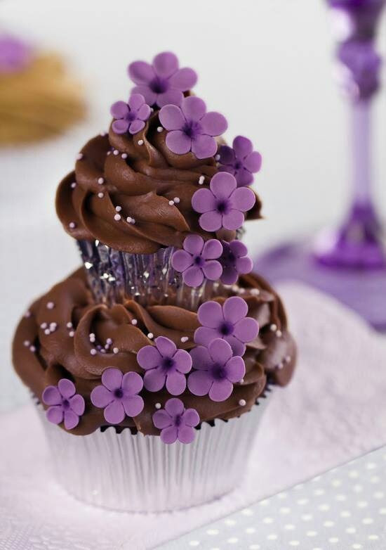 My two favorite things purple,flowers,chocolate all put in one my favorite foods cupcakes!!!