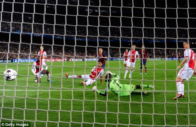 Number two: Messi slots his second goal past the helpless Vermeer