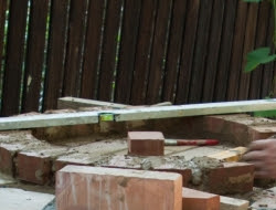 DIY Outdoor Kitchen and Pizza Oven - First row of bricks