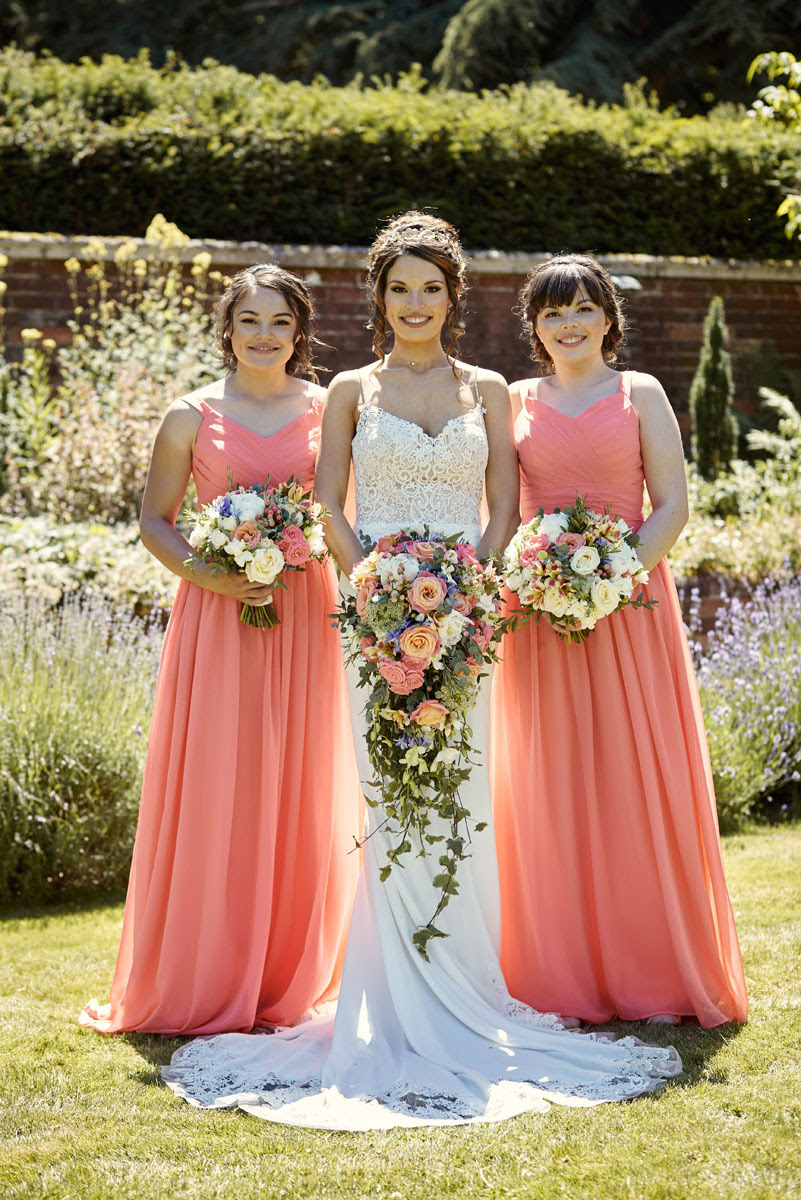 Group photo of bride and bridesmaids in gardens at Lanwades Hall Wedding Photos - helloromancephotography.com