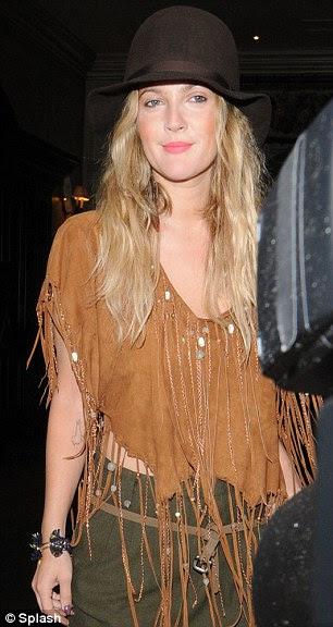 Festival chic: Drew Barrymore leaves her London hotel en route to the festival