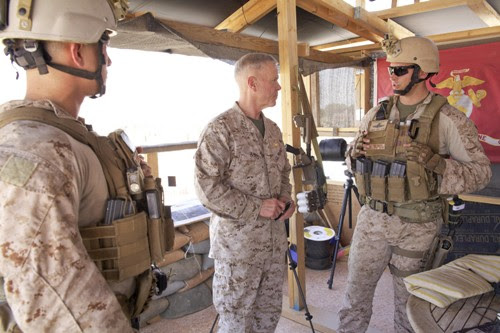 Commandant Gen. Jim Amos, visits the U.S. embassy compound in Tripoli, Libya, on June 16, 2013. He is speaking with a member of 4th Force Reconnaissance Company. by Pan-African News Wire File Photos