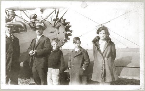 Biplane and seven people