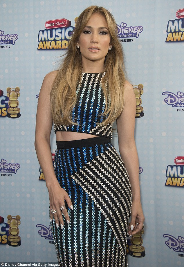 Making an entrance: Jennifer Lopez looked gorgeous in an asymmetrical, midriff-baring ensemble as she arrived at the Radio Disney Music Awards in LA on Saturday