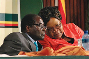 President Robert Mugbe and Vice President Joice Mujuru of the Republic of Zimbabwe. The country has battled the sanctions of western imperialism for over a decade. by Pan-African News Wire File Photos