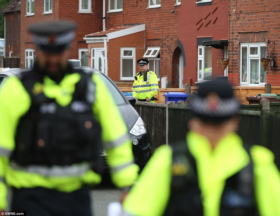 A huge number of police - including armed officers - carried out a raid on a house in the Fallowfield area of the city. They remained on guard today (pictured)