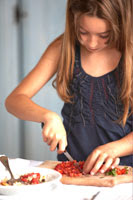 girl cutting fruit