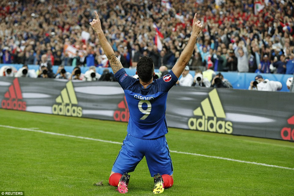 France's No 9 slides on his knees and points to the heavens after giving his country the lead as they dominated against Iceland