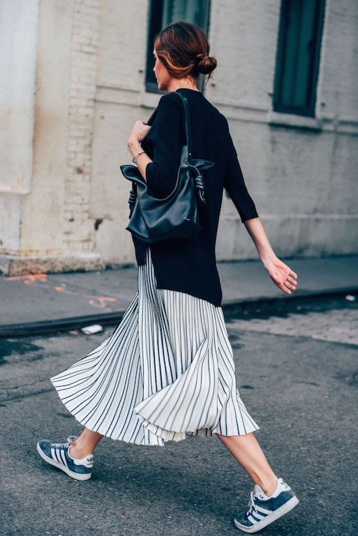 Le Fashion Blog 25 Ways To Wear Adidas Sneakers Sweater Stripe Midi Skirt Blue White Stripe Street Style Via Tommy Ton