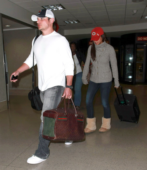 Nick Lachey Actress Vanessa Minnillo and Nick Lachey arriving on a flight at LAX airport in Los Angeles, CA on January 13, 2012.