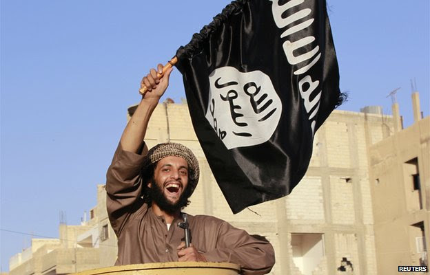 A militant islamist fighter takes part in an ISIS parade in Syria's eastern city of Raqqa June 30 2014