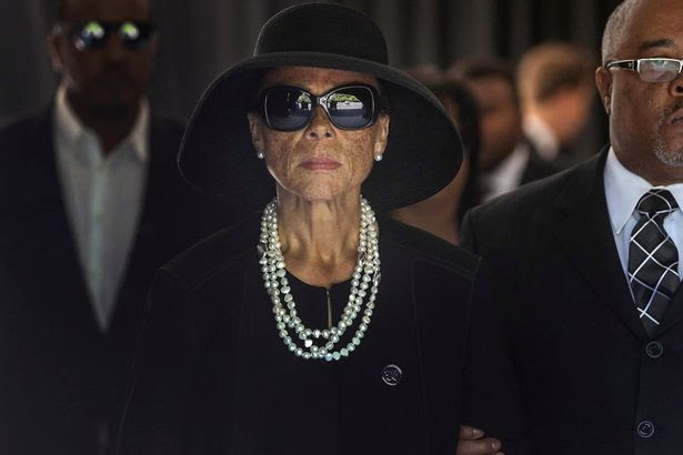 Lonnie Ali, widow of Muhammad Ali, leaves the funeral home to begin a procession through his hometown of Louisville, Kentucky