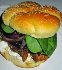 Balsamic glazed chicken sandwiches with red onions and goat cheese