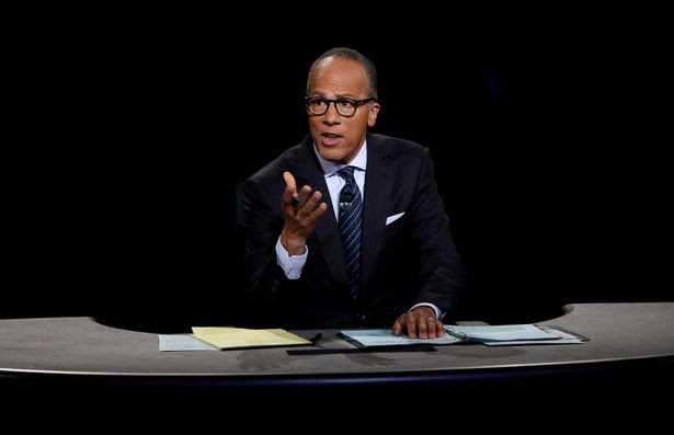 Moderator Lester Holt listens during the Presidential Debate