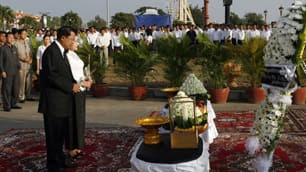 Cambodian Prime Minister Hun Sen and his wife, Bun Rany, pay their respects to stampede victims on a day of mourning in Phnom Penh.
