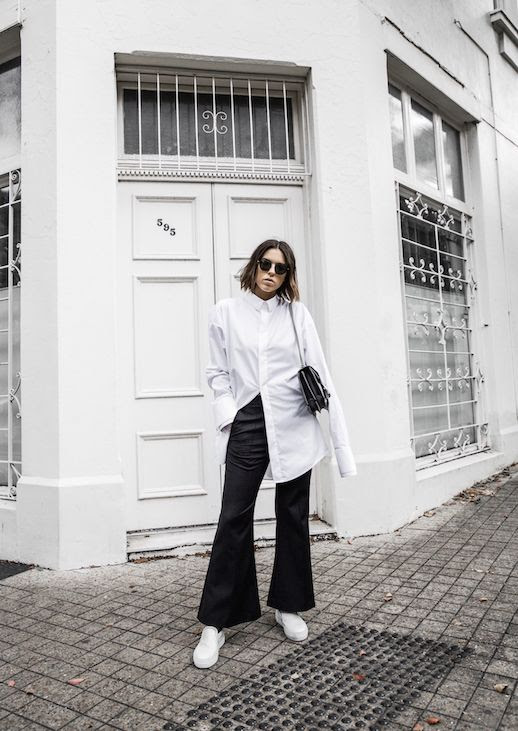 Le Fashion Blog Long White Button Down Flare Black Trousers White Sneakers Via Modern Legacy