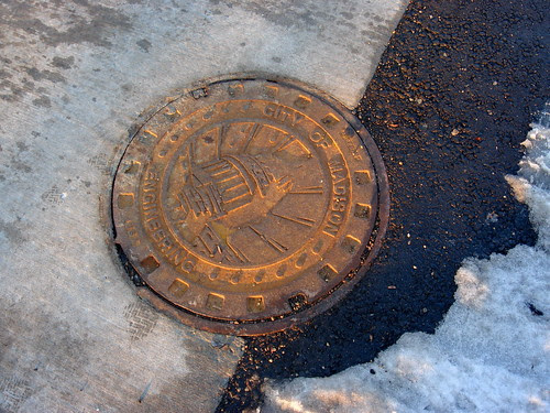 Madison manhole cover