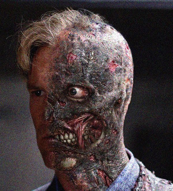 Aaron Eckhart as Harvey Dent, a.k.a. Two-Face.