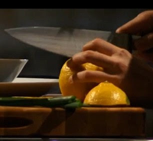 The blind chef is seen deftly cutting into her ingredients including a lemon