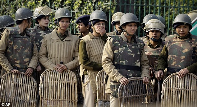 Riot gear: Indian policewomen stand guard at a checkpoint following the death of the gang-rape victim