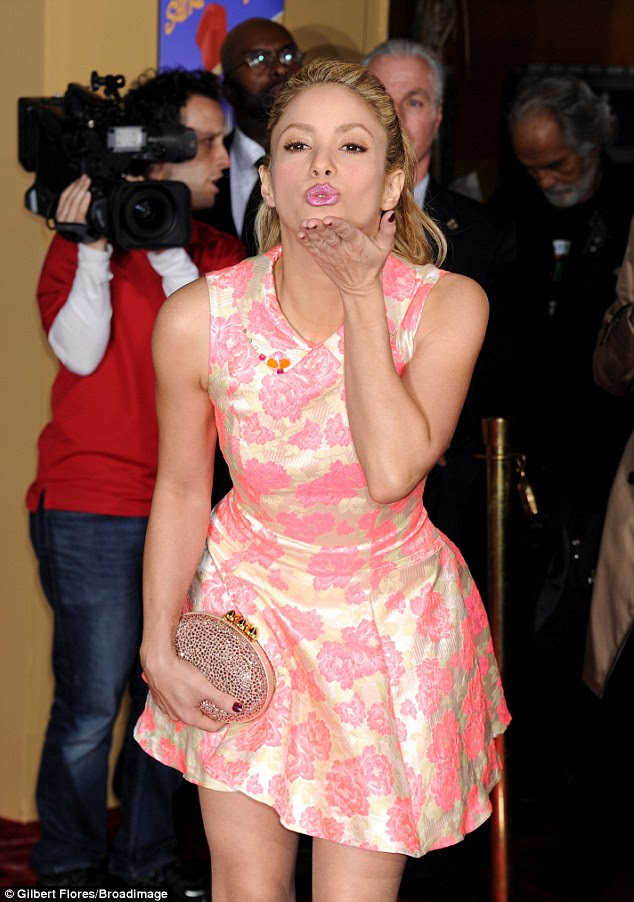 Flirty display: The musician enjoyed her red carpet moment and blew kisses to the cameras