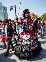 Costumed participants attend the Tokyo Rainbow Pride