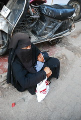Please Dont Ask If She is a Shia or a Sunni.. She is certainly not a Wahabbi they dont beg on the Streets ..Luckily they were born Rich by firoze shakir photographerno1
