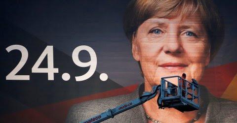 Cartel electoral de Angela Merkel.REUTERS/Wolfgang Rattay