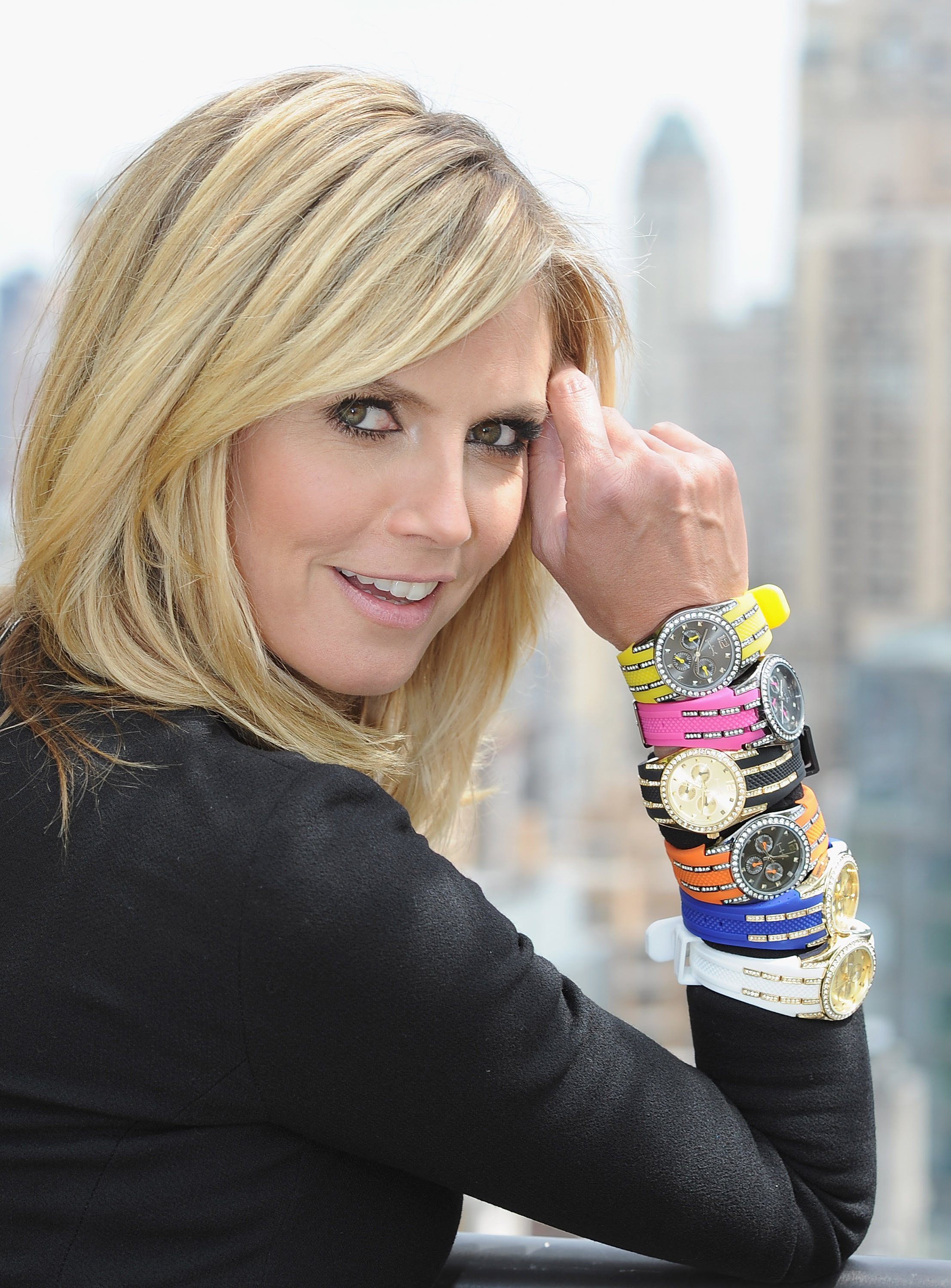 Heidi Klum at the Hudson Hotel, shows off her stacked watches and bangles. (Dimitrios Kambouris/Getty Images for QVC)