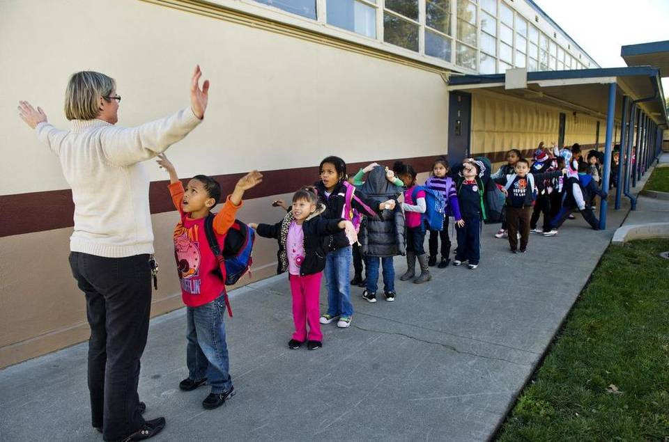 Katherine Hoffmore, 48, occupies her students in line at Greer Elementary as they get ready to go home for the day. Expected to cost about $7.5 million a year for salaries and benefits, the decision to lower class sizes brings the district in line with a new state formula that gives districts more money if they reduce their class sizes by the year 2020. Sacramento City Unified plans to add 75 teachers at 47 schools.