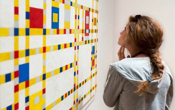 """Broadway Boogie-Woogie"" and other Mondrian paintings at the Museum of Modern Art blend symmetry with a tensile volatility.<a href=""http://www.nytimes.com/2015/08/21/arts/design/mondrians-paintings-and-their-pulsating-intricacy.html""> Related Review</a>"