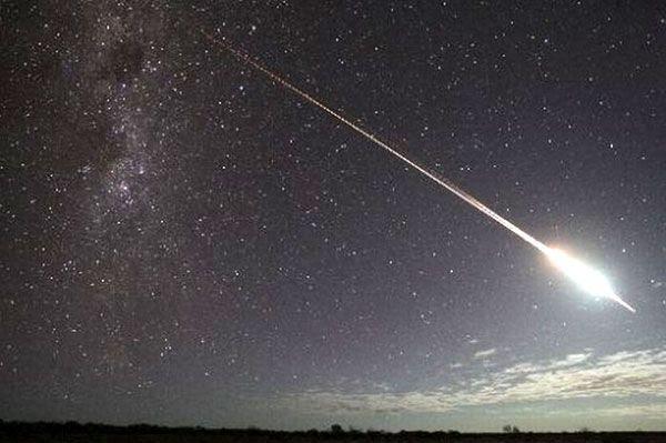 HAYABUSA's sample return capsule enters Earth's atmosphere on June 13, 2010.