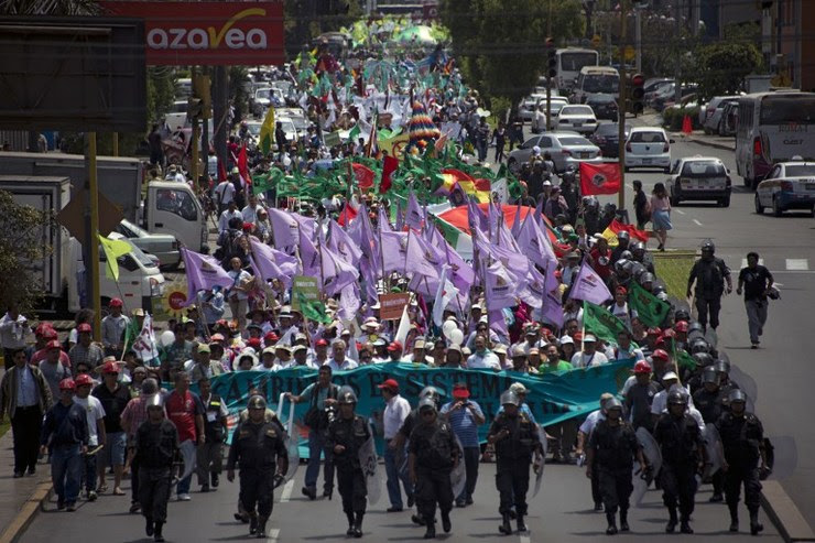 MARCH FOR THE EARTH. The People's Climate March on the sidelines of the UN COP20 and CMP10 climate change conferences being held in Lima on December 10, 2014. Eitan Abramovich/AFP
