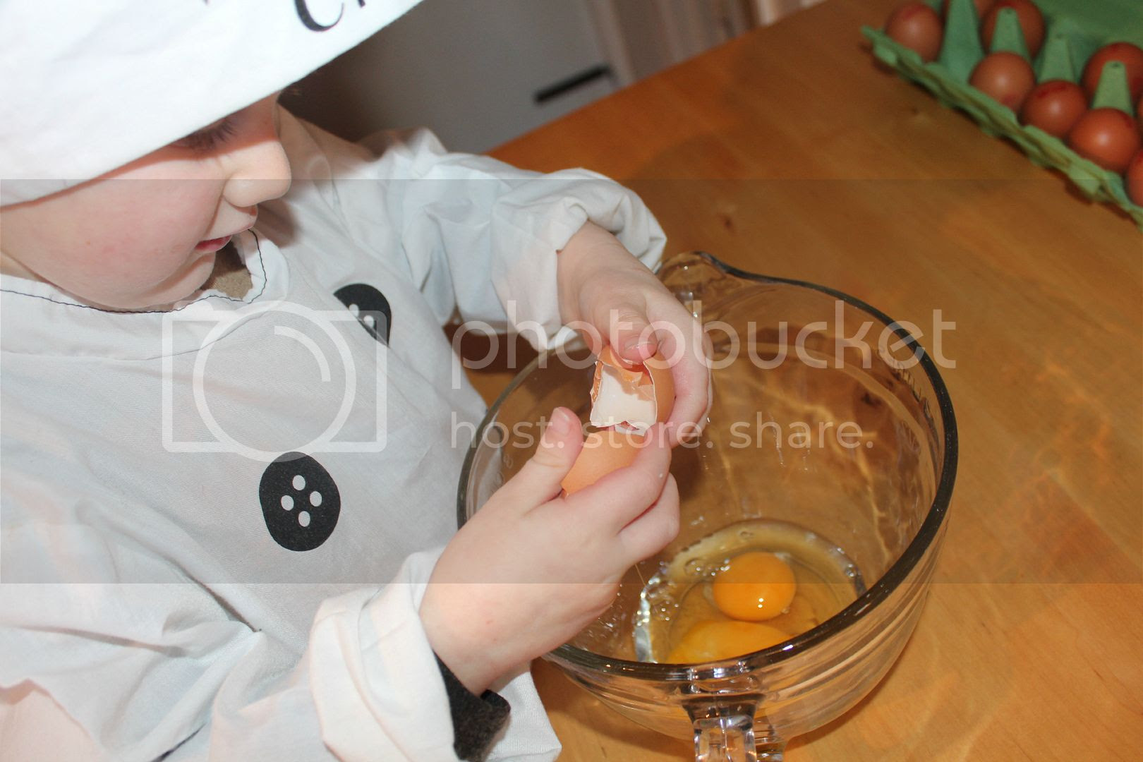 child cracking an egg