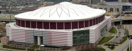 This Feb. 28, 2001 file photo shows an aerial view of the Georgia Dome in Atlanta. Authorities say a 20-year-old man who plunged about 35 feet from the Georgia Dome's upper level and struck another fan during the Tennessee-North Carolina State college football game has died. (AP Photo/Atlanta Journal-Constitution, Rich Addicks)