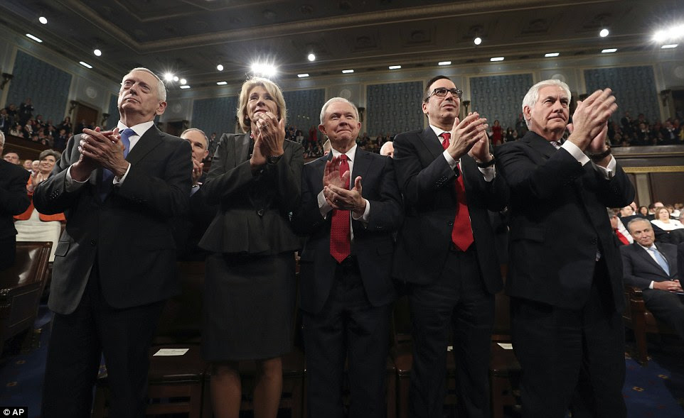 Defense Secretary Jim Mattis, Education Secretary Betsy DeVos, Attorney General Jeff Sessions, Treasury Steve Mnuchin and Secretary of State Rex Tillerson applaud the president's address