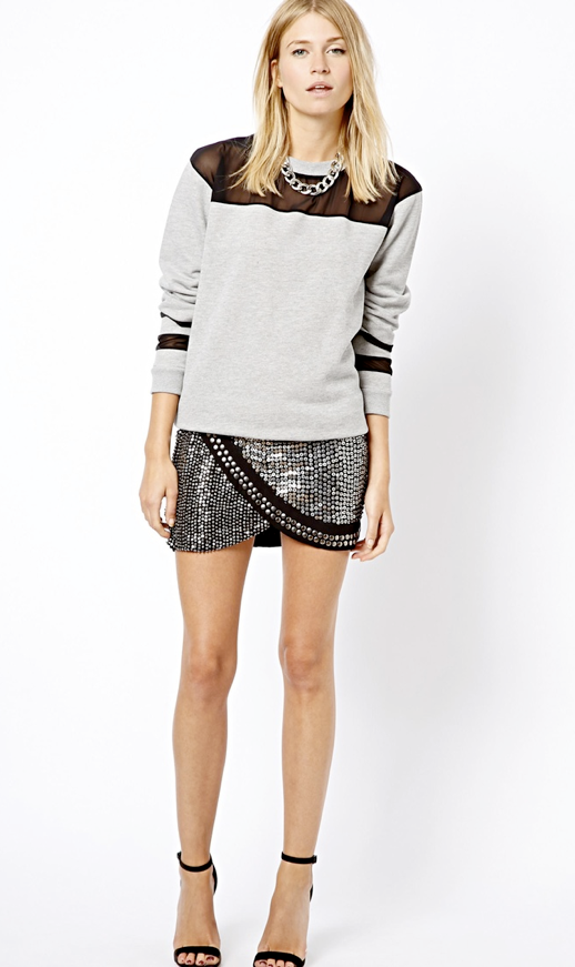 LE FASHION BLOG SPORTY SEQUIN STUDS SWEATSHIRT SKIRT HEELS Mango Embellished Mini Wrap Skirt ASOS Sweatshirt with Sheer Panels SILVER CHAIN NECKLACE SIMPLE MINIMAL ANKLE STRAP HEELED SANDALS HEELS ATHELTIC SPORT CHIC photo LEFASHIONBLOGSPORTYSEQUINSTUDSSWEATSHIRTSKIRTHEELS.png