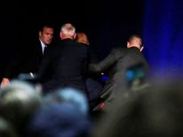 Donald Trump is hustled off the stage by security agents after a perceived threat in the crowd