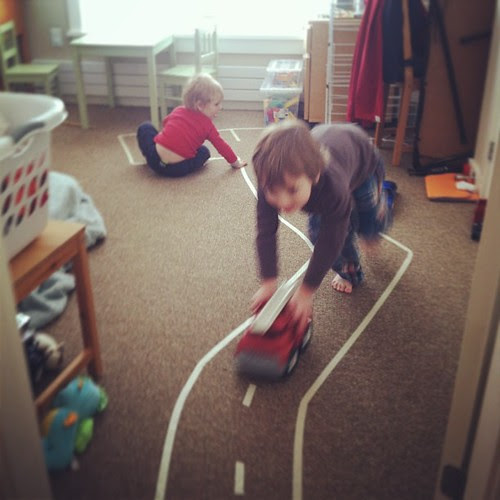 Trying to distract from sibling fighting by making a masking tape road on the floor.