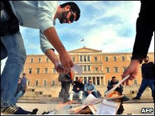 Greek stage workers light fires outside parliament in Brussels